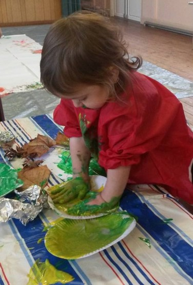 1-getting-hands-on-painting-with-leaves-big-floor-art-in-the-background